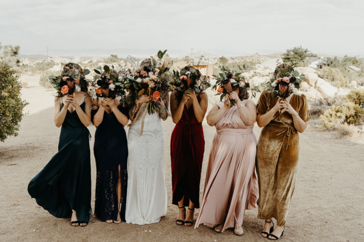 The bridesmaids were wearing mismatching maxi dresses in bold colors and minimalist shoes