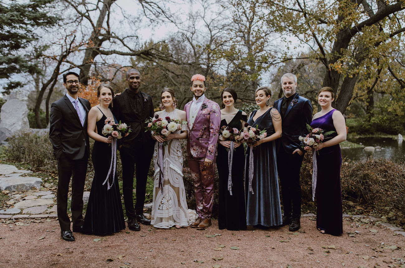 The bridesmaids were wearing mismatching velvet dresses, and the groomsmen were rocking mismatching suits