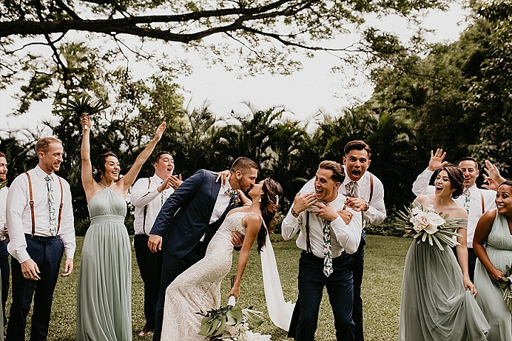 The groomsmen were wearing white shirts, navy pants, leather suspenders