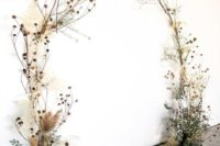 06 a fantastic wedding ceremony arch of eucalyptus, dried leaves and herbs plus dried billy balls
