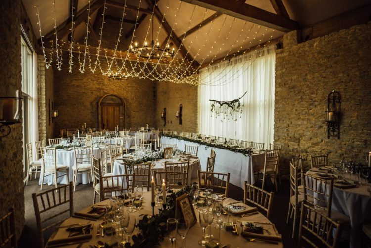 The barn venue was decorated with lights, greenery, candles and neutral linens