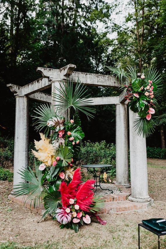 a tropical-inspired wedding altar