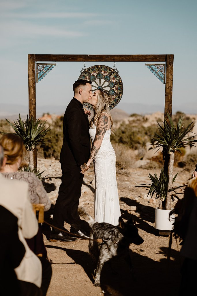 The wedding arch was decorated with mosaic glass and some palm trees to highlight the location