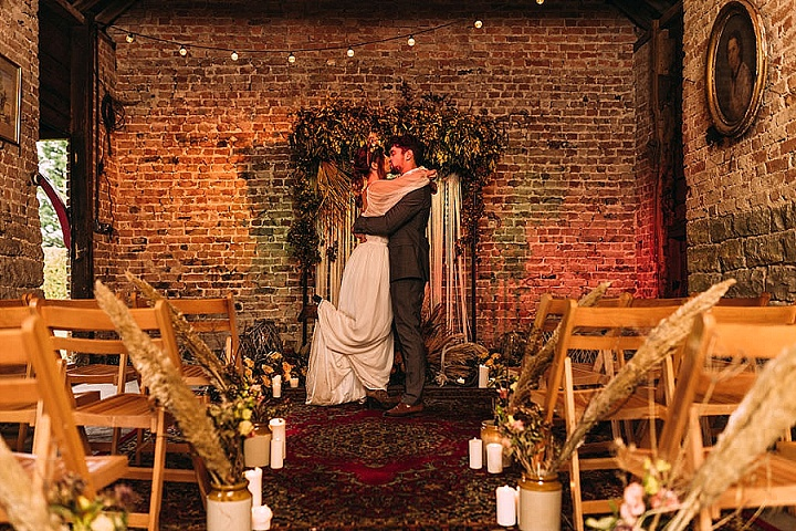 a gorgeous indoor wedding backdrop with ribbons