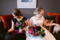 07 The wedding bouquets were done with red, fuchsia and dark purple blooms and greenery