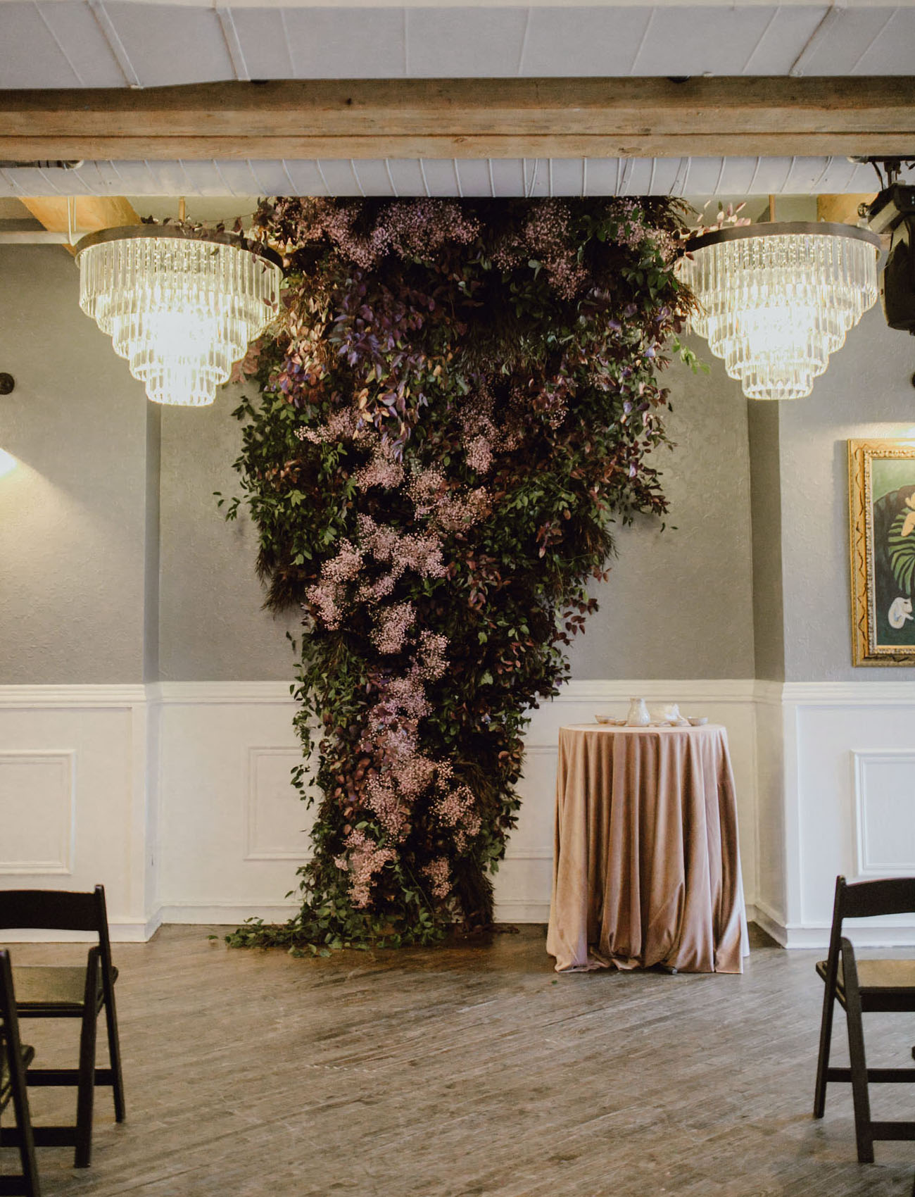 There was a moody and refined floral wedding altar inside