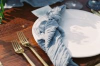 07 a blue gauze table runner and a matching napkin for a beautiful and ethereal wedding tablescape