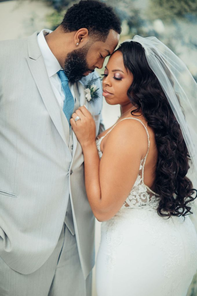 The groom was wearing a dove grey three-piece suit with an ice blue tie and a thistle boutonniere