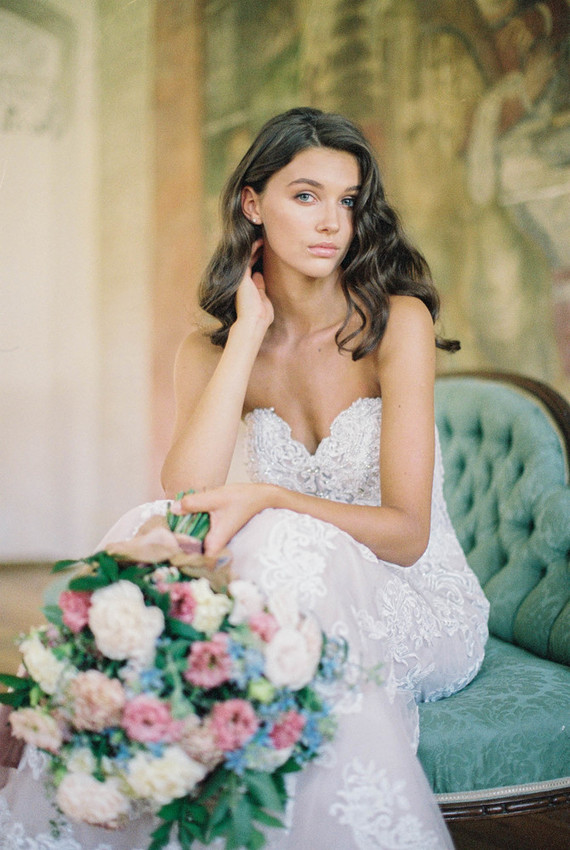 The wedding dress looks totally different without the cape - it's lace and embellished