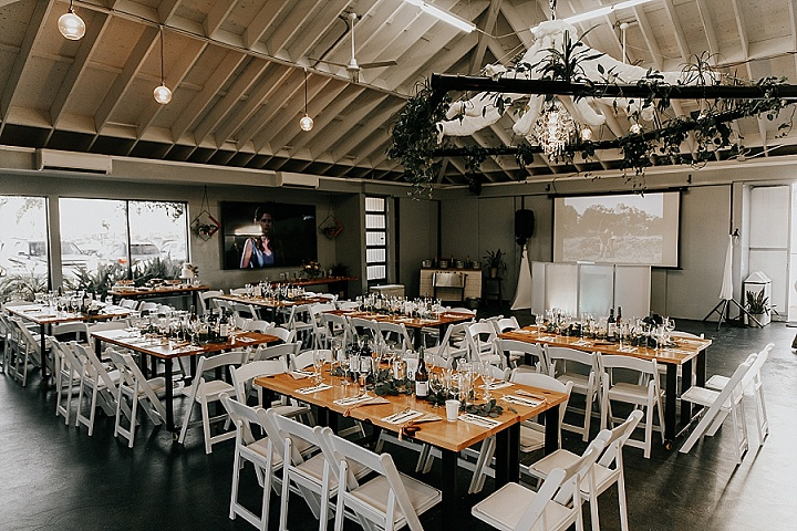 The wedding venue was done with greenery runners, neutral fabric and naked tables