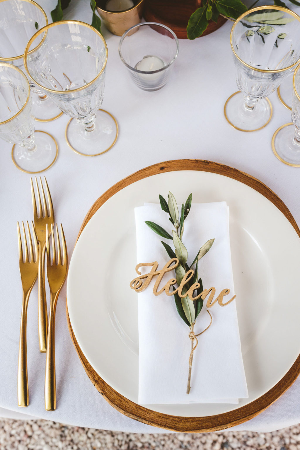 Gold cutlery, gold rim glasses and wooden chargers finished off the look