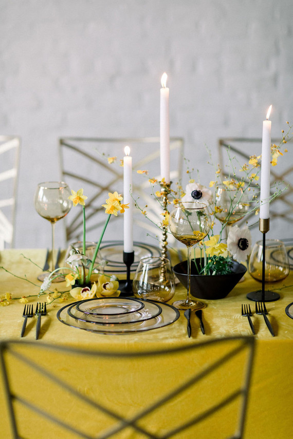 I love the combo of white elegant candles and dramatic black vases and candleholders plus yellow blooms