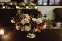 09 The centerpieces were elegant and moody and reminded of the bouquet