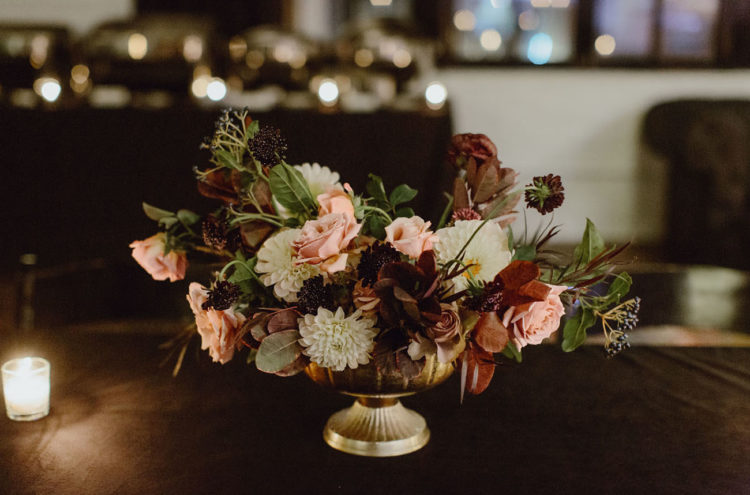 The centerpieces were elegant and moody and reminded of the bouquet