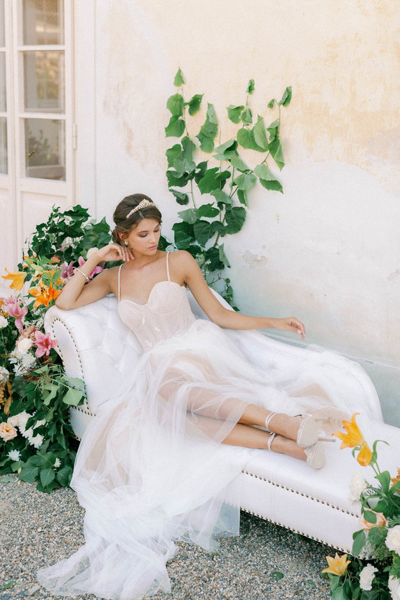 The second wedding dress was a neutral bustier one, with spaghetti straps, a sheer skirt and the bride was rocking a crown