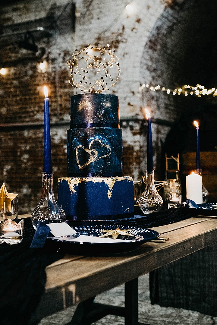 a moody dark blue wedding cake design