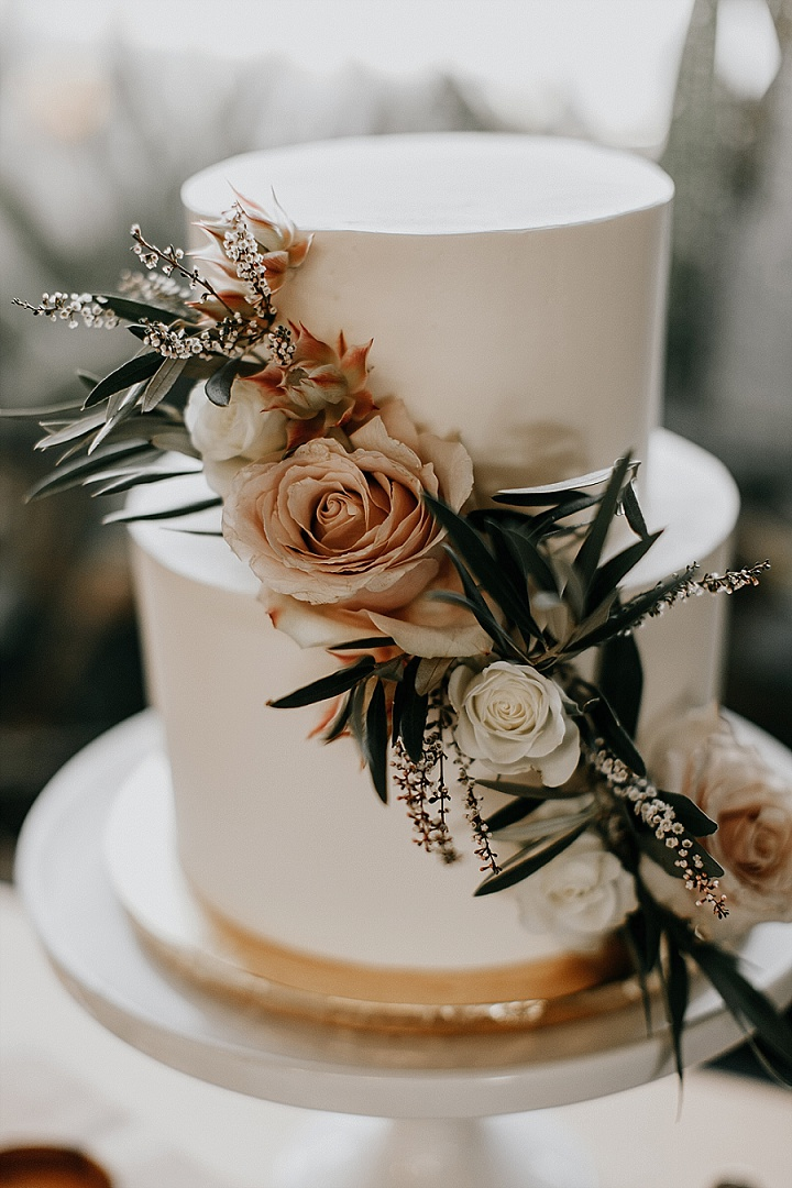 The wedding cake was a white one, with neutral and blush blooms and greenery
