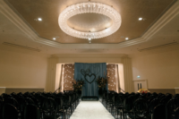 09 The wedding ceremony space was done with black chairs and vases with pampas grass, greenery and blush blooms