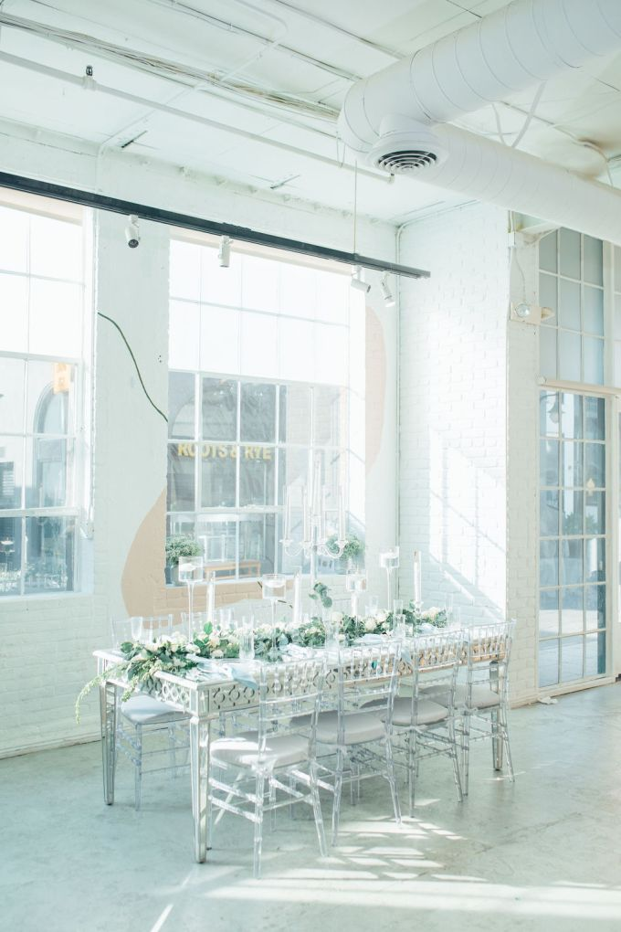 The wedding reception table was done in white, with sheer chairs and lots of frosty and icry details