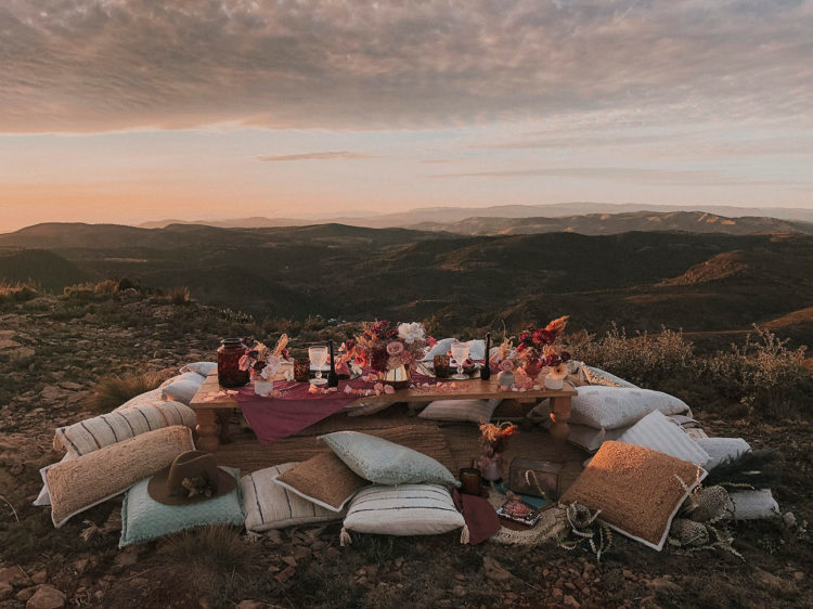 The wedding reception was boho, styled as a cozy picnic