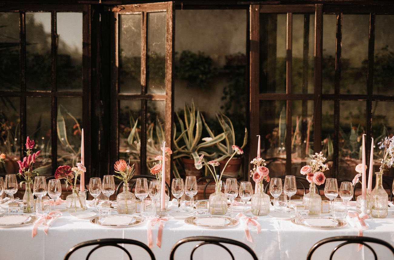 The wedding table was family style, with pink candles and bright blooms