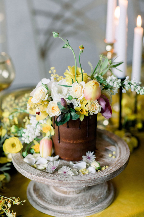 a cute chocolate wedding cake with bold blooms