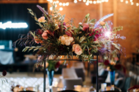 10 The wedding tablescapes were done with candles, lush florals and greenery