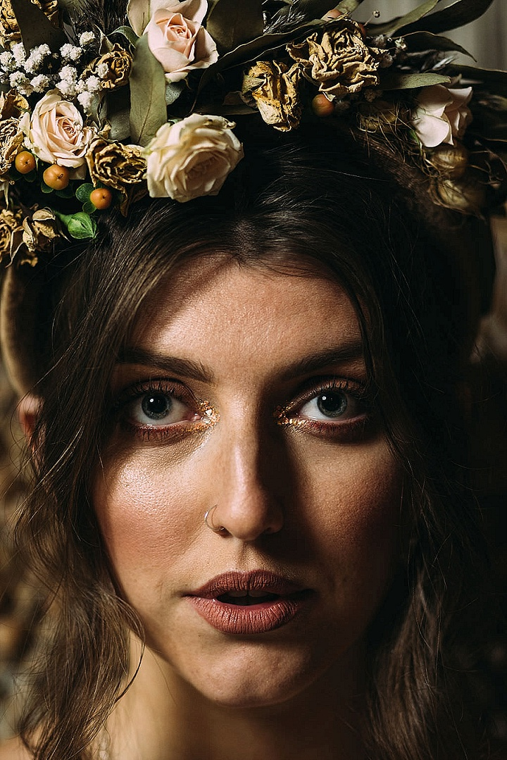 I totally love the lush floral crown, a gold hued makeup and a tiny and elegant nose piercing