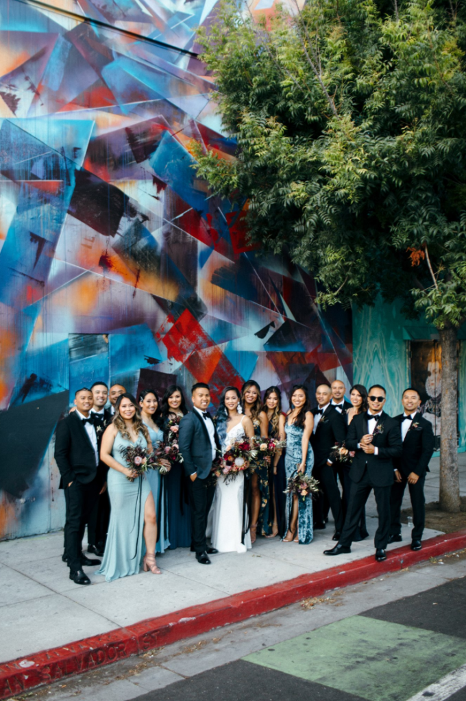 The bridesmaids were wearing mismatching blue maxi dresses, and the groomsmen were rocking black tuxes