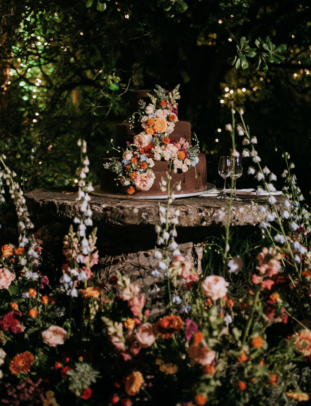 The wedding cake was chocolate and with bright blooms and greenery