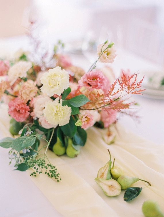 a bright floral centerpiece for a pastel wedding