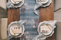 11 a printed blue table runner, matching light blue napkins and chargers create an ethereal and chic tablescape