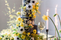 12 The second wedding cake was a real masterpiece in black, with handpainting and bold yellow and white blooms