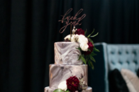 12 The wedding cake was a grey marble one, with white and burgundy blooms and a calligraphy topper