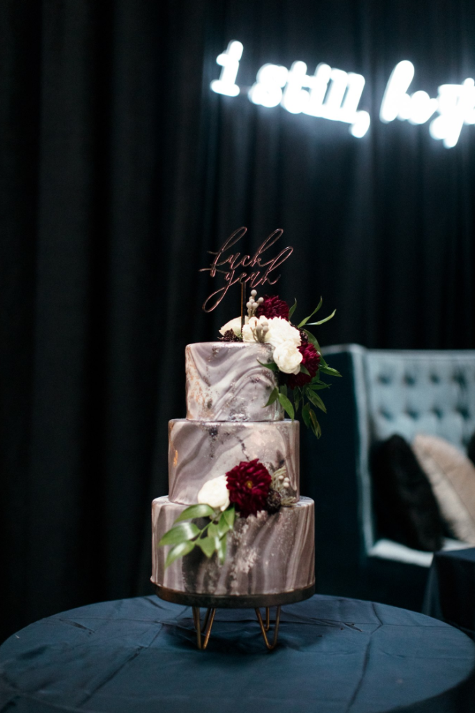 The wedding cake was a grey marble one, with white and burgundy blooms and a calligraphy topper