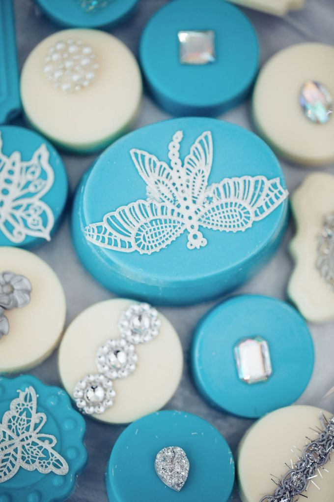 The wedding mini cakes were icy blue and white ones, with shiny touches and glazing