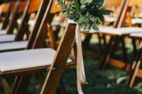 29 decorate your wedding aisle chairs with textural greenery and ribbons for a chic and simple look
