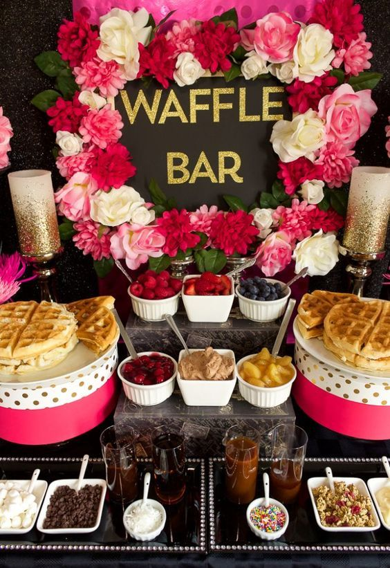 0 2a bold and glam waffle bar with bright pink and white blooms, pink and polka dot stands, waffles, fruits, sauces and dips