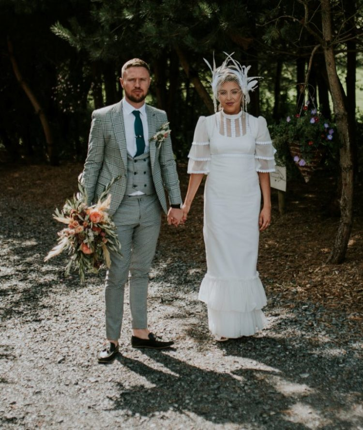 This couple went for a non traditional and cool wedding, and you can easily see that from their outfits