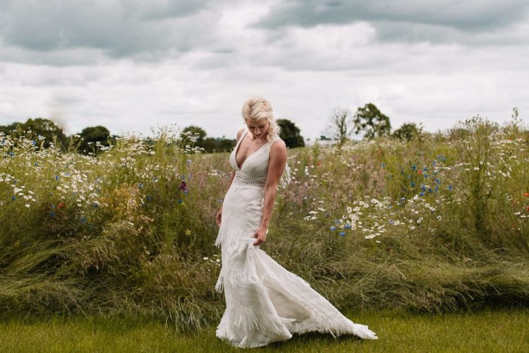 One bride was wearing a sheath boho wedding dress with a deep neckline and beading and fringe