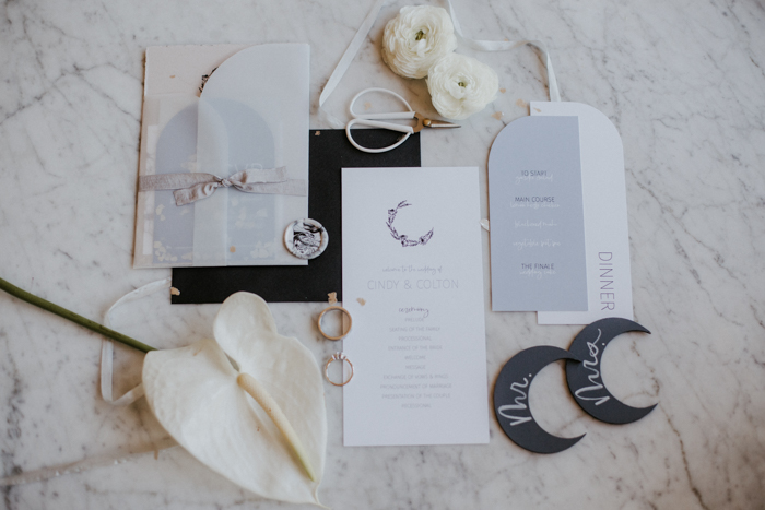 The wedding invitation suite was done in neutrals, powder blue and black, with moon decor