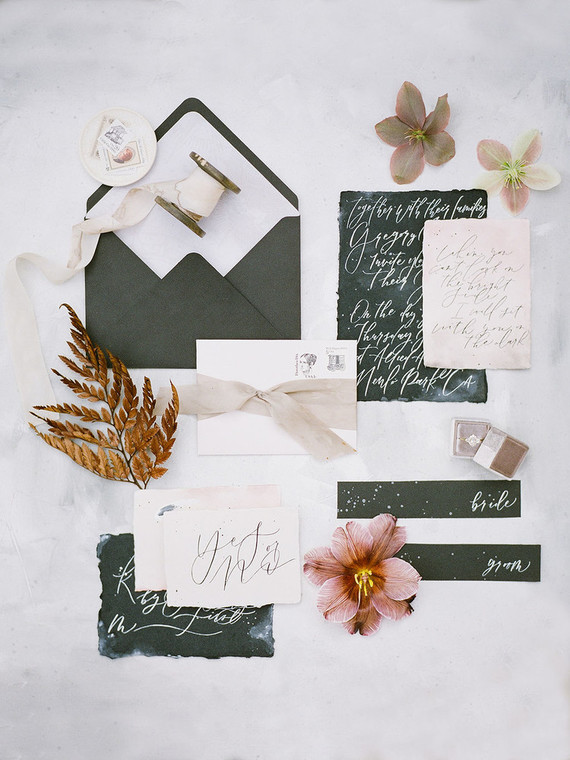 The wedding stationery was done in black and blush, with a raw edge and ribbons