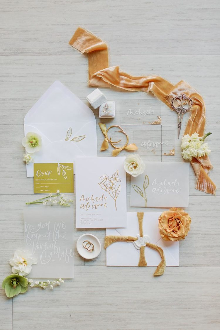 The wedding stationery was done with mustard and rust touches, with floral and gold leaf touches