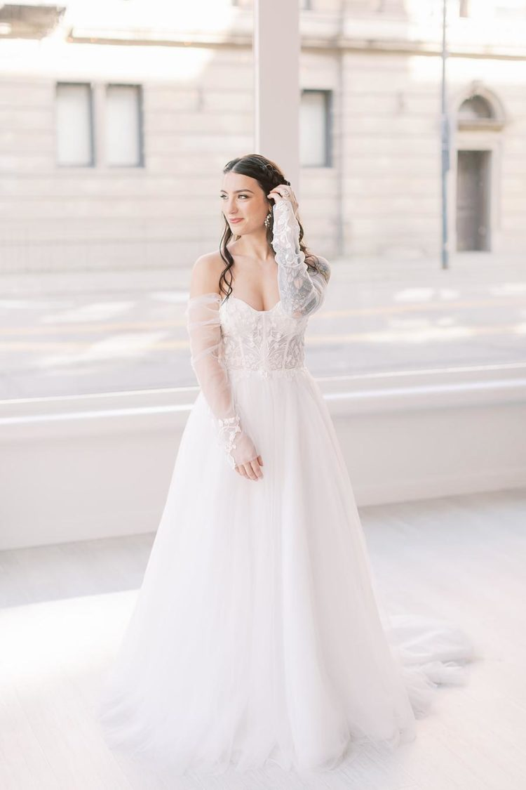 One bride was wearing a gorgeous off the shoulder A-line lace wedding dress with long sleeves and curls