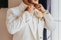 03 One groom was wearing a white three-piece wedding suit with hand painted flowers