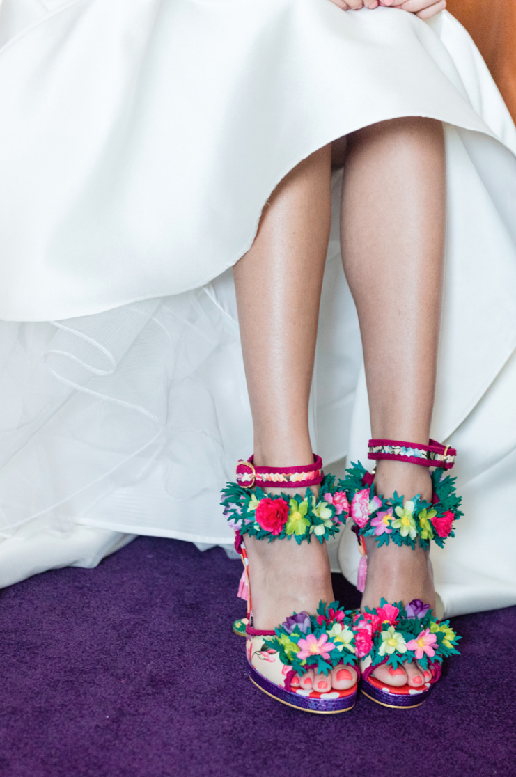 She finished off her look with crazy colorful shoes with flowers and fringe