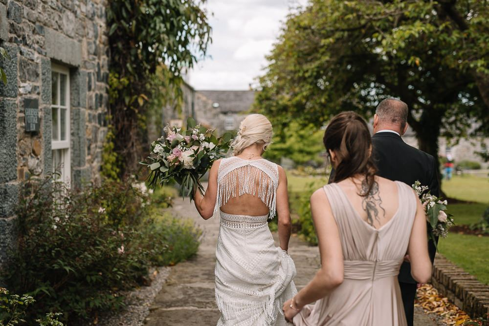 The back of the dress was open, with long fringe hanging down