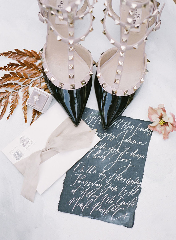 The bride was wearing black and blush spiked heels that gave an edge to her look