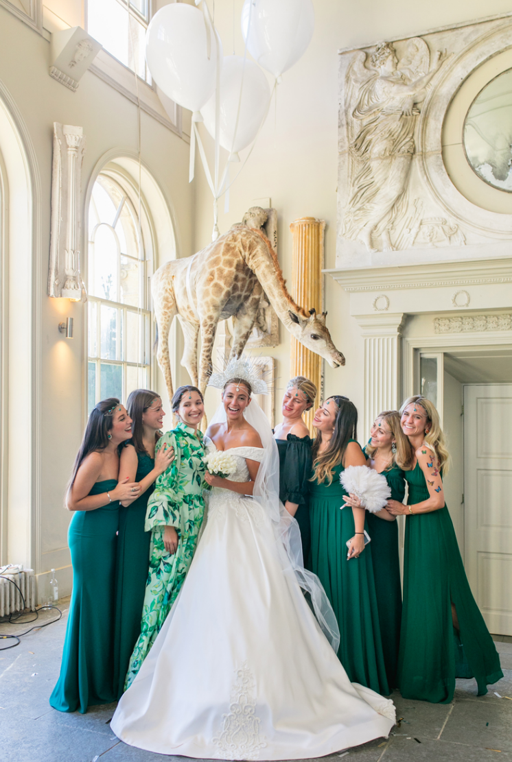 The bridesmaids were wearing mismatching dresses in all shades of green