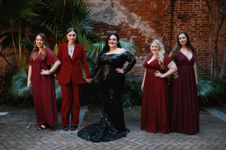 The bridesmaids were wearing mismatching red and burgundy looks and black shoes